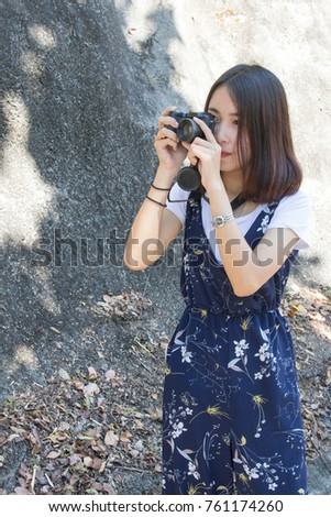 Woman tourist taking pictures on vacation.