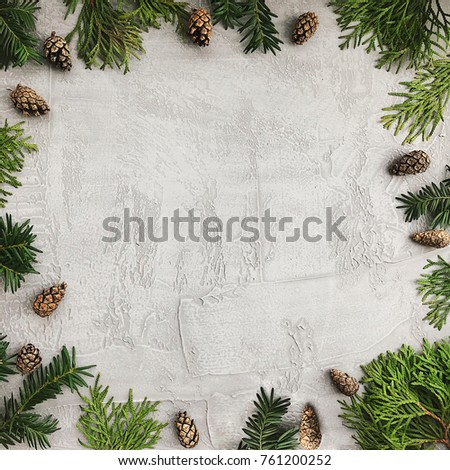 Christmas background with fir branches and pine cones. Floral New Year frame. Border with copy space. #761200252