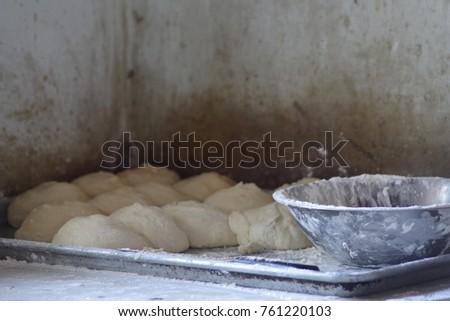 Homemade dough balls ready to be baked. #761220103