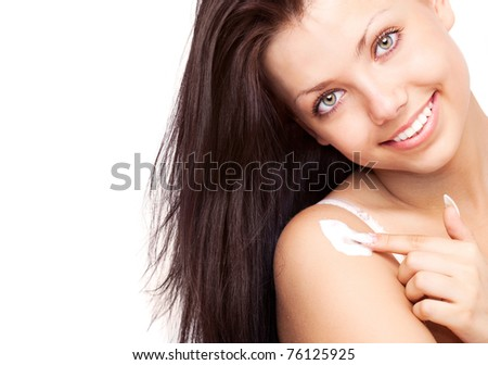 beautiful young brunette woman applying body lotion, isolated against white background #76125925