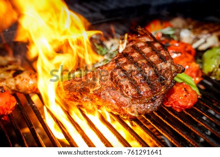 steak cooking on fire with vegetables #761291641