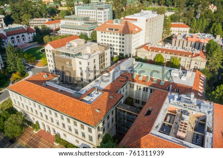 Aerial view of buildings in University of California, Berkeley campus on a sunny autumn day, San Francisco bay area, California; the shadow of Campanile tower visible in the photo