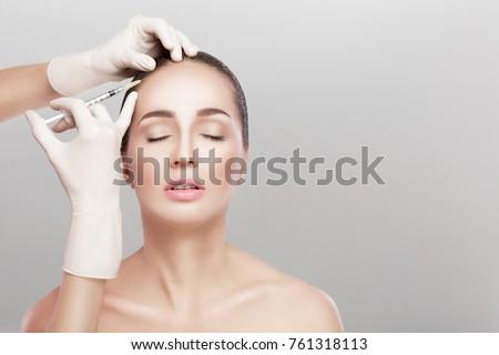 Needle mesotherapy. Cosmetic been injected in woman's head. strengthen the hair and their growth #761318113