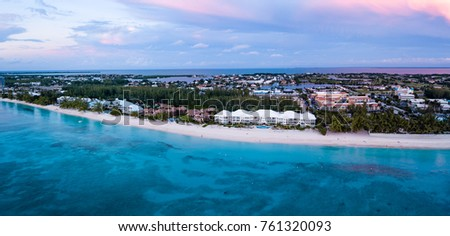 panoramic aerial view of seven mile beach in the tropical paradise of the cayman islands at sunset #761320093