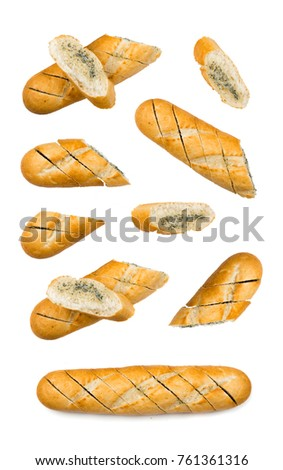 Baguette with garlic butter and aromatic herbs. Top view food photography #761361316