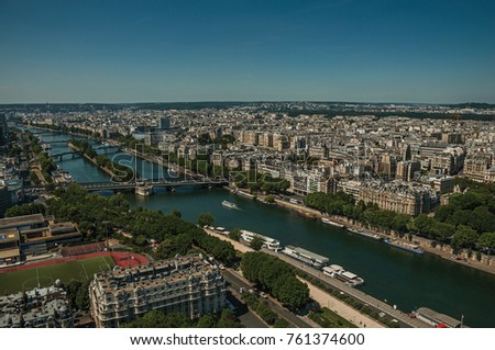 "Skyline, River Seine, greenery and buildings under blue sky, seen from the Eiffel Tower in Paris. Known as the ""City of Light"", is one of the most impressive world's cultural center. Northern France. #761374600"