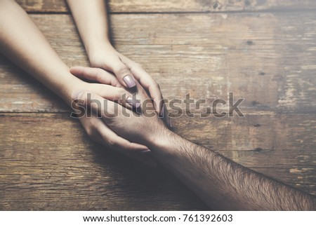 two young lovers holding hands at a table #761392603