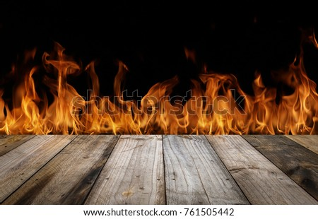 Wood top divides 1 to 2 parts on Fire flames black background - can be used for display or montage your products