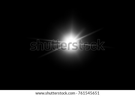 digital lens flare,sun burst on black background. #761545651