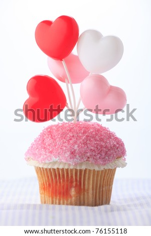 Colorful birthday cupcake on white background