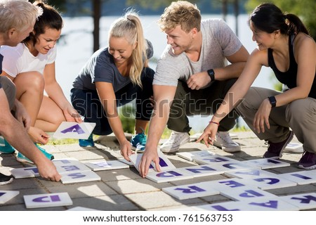 Business People Smiling While Solving Crossword On Patio #761563753