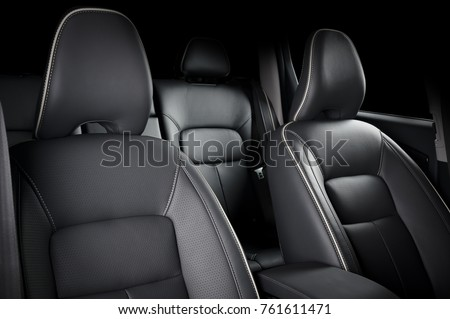 Luxury car inside. Interior of prestige modern car. Comfortable leather seats. Black perforarated leather cockpit. #761611471