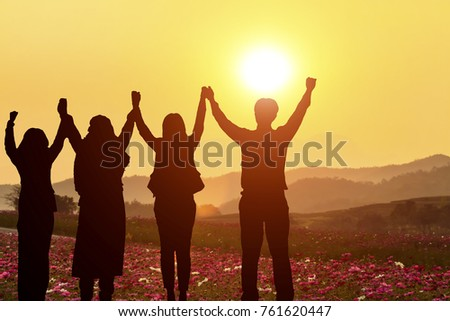 Silhouette of happy business team making high hands in sunset sky background for business teamwork concept and plane #761620447