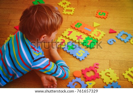 little boy playing with puzzle, education concept #761657329