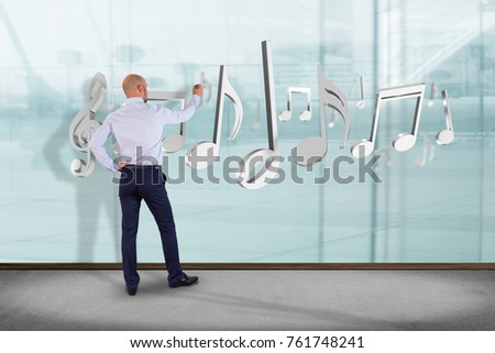 View of a Businessman in front of a wall with 3d render music notes
