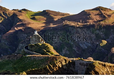 St Nicholas chapel in Ilfracombe, North Devon at sunrise with hillside Royalty-Free Stock Photo #761838967