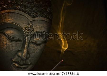 Buddha image with incense
