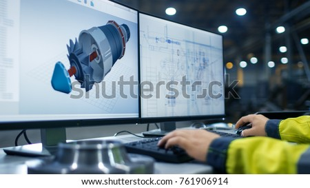 Inside the Heavy Industry Factory Close-up Footage of  Industrial Engineer's Hands Working on the Personal Computer with Two Monitors Designing Turbine/ Engine in 3D, Using CAD Program. #761906914