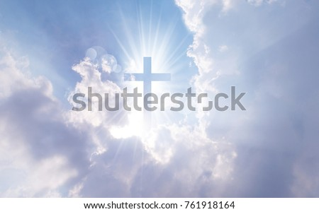 Christian cross appears bright in the sky background Royalty-Free Stock Photo #761918164