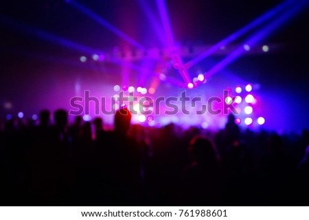 texture blur scene multicolored lights and smoke in concert with silhouettes of peopleBackground for design, blur texture, actors on stage #761988601