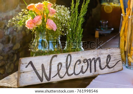 Welcome sign painted on wood