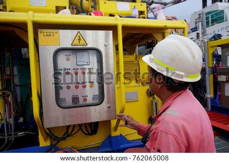 SARAWAK, MALAYSIA - MAY 30th, 2017: Unidentified offshore worker doing maintenance to the dive spread LAR-1. #762065008