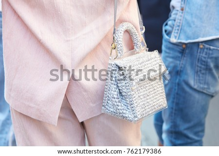 MILAN - SEPTEMBER 22: Woman with transparent plastic and fabric bag and pink suit before Sportmax fashion show, Milan Fashion Week street style on September 22, 2017 in Milan. #762179386