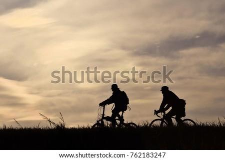 Bicycle running along the bank #762183247