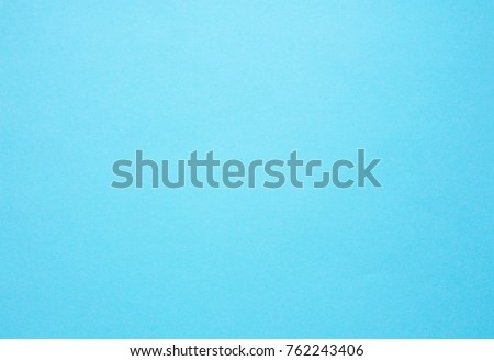 Blue paper in pastel colours. Abstract blue background.