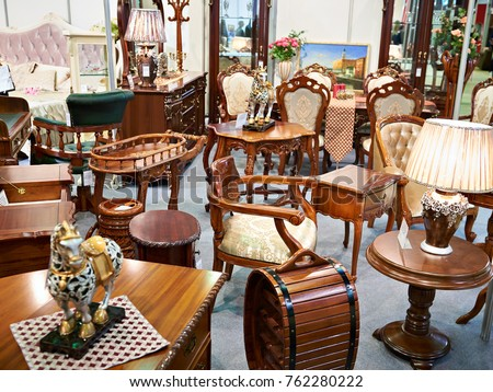 Antique furniture store with wooden goods Royalty-Free Stock Photo #762280222
