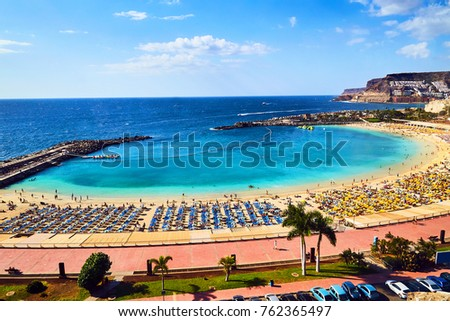 Beautiful aerial view of Playa de Amadores beach in puerto rico in Gran Canaria island in Spain. Gorgeous sea shore of the Canary islands. #762365497