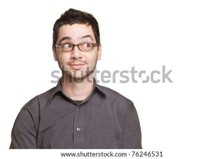 Young man looking at copyspace having a surprised or satisfied look isolated on white background