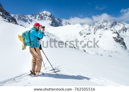 A skier walks in the mountains #762505516