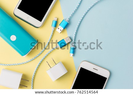 USB charging cables for smartphone and tablet in top view Royalty-Free Stock Photo #762514564