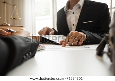 The hard work of an asian lawyer in a lawyer's office. Counseling and giving advice and prosecutions about the invasion of space between private and government officials to find a fair settlement. Royalty-Free Stock Photo #762545014