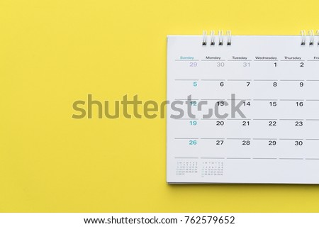 close up of calendar on yellow background, planning for business meeting or travel planning concept