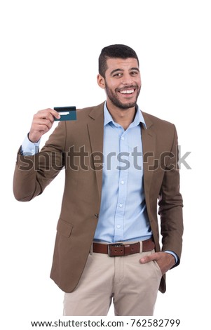 a cheerful man holding his credit card and feeling satisfied.  Isolated on white background. #762582799