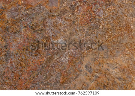 Wet rusty sheet metal as a natural background or texture. #762597109