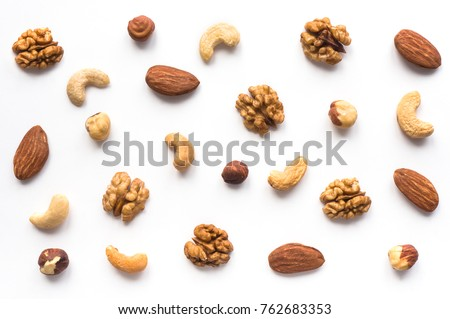 Isolated nuts pattern backdrop. Walnut, cashew, almond and hazelnut  on white background. Top view.  Royalty-Free Stock Photo #762683353