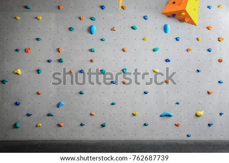 Grey wall with climbing holds in gym #762687739