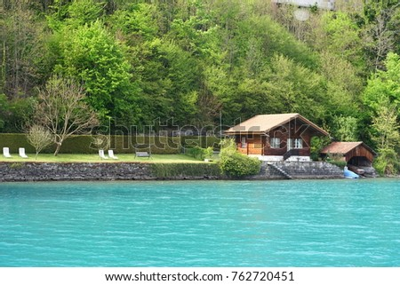 Small house at a blue lagoon, Switzerland. #762720451
