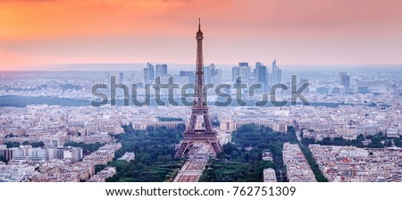 Paris, France. Panoramic view of Paris skyline with Eiffel Tower in the center. Amazing sunset scenery with dramatic sky.