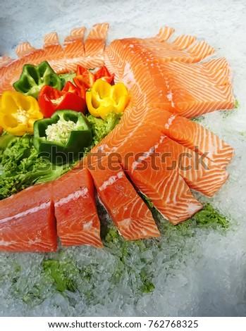 Raw salmon slice or salmon sashimi in Japanese style fresh serve on ice. #762768325