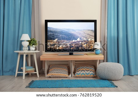 Cozy interior of living room with TV on stand Royalty-Free Stock Photo #762819520