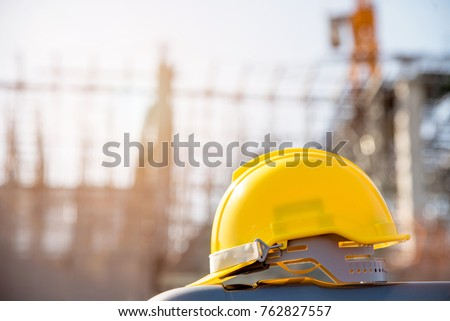 helmet in construction site and construction site worker background  safety first concept Royalty-Free Stock Photo #762827557