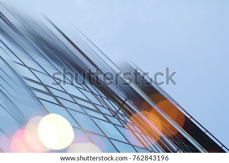 Abstract business modern city urban futuristic architecture background. Real estate concept, motion blur, reflection in glass of high rise skyscraper facade, toned blue picture with bokeh #762843196