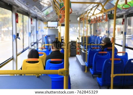The passengers are inside the bus #762845329