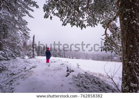 Girl and winter wiew from Sotkamo, Finland. #762858382