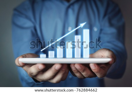 Businessman holding business graph.  #762884662
