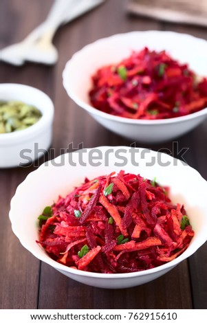 Raw grated beetroot, apple and carrot salad with parsley, photographed with natural light (Selective Focus, Focus one third into the image) #762915610